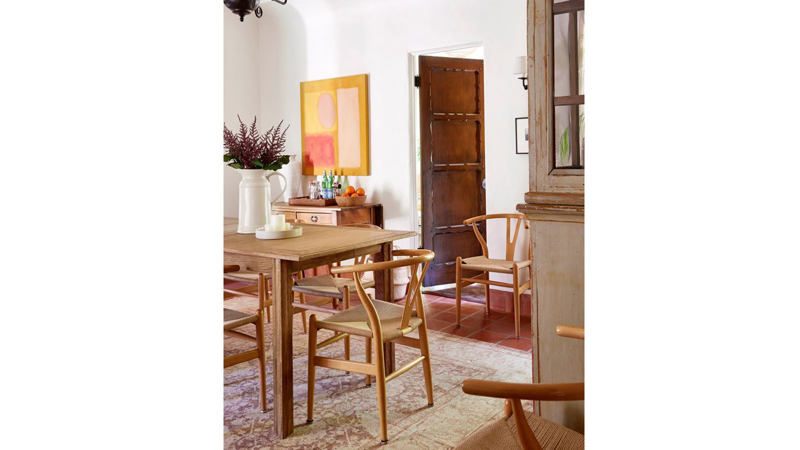 The dining room features Hans Wegner wishbone chairs.