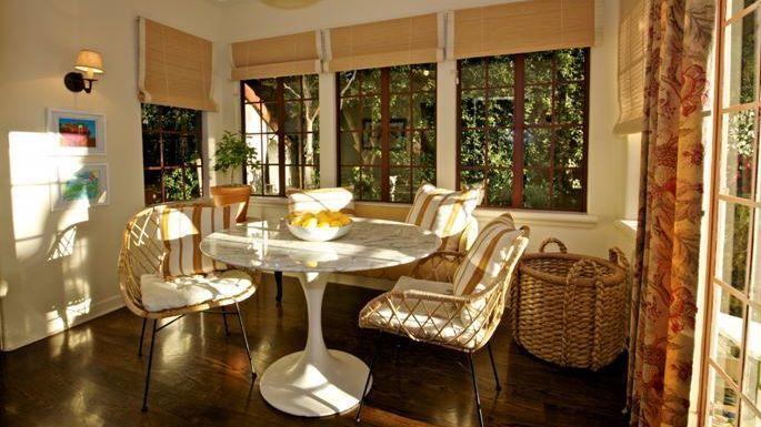 Yellow and white striped cushions soften a marble-topped Saarinen dining table,