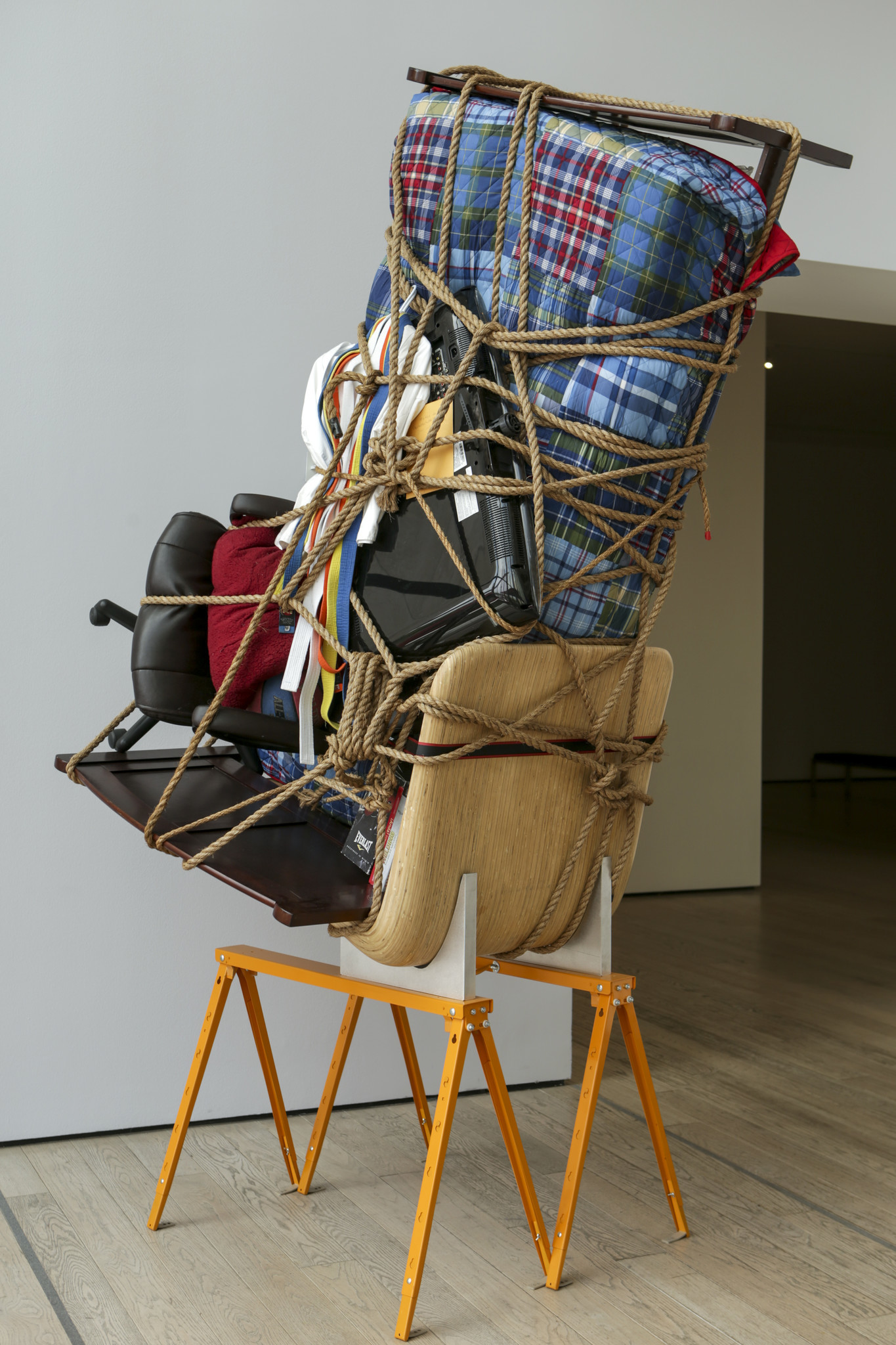 """An installation view of Juan Manuel Montes' belongings in """"Temporary Storage"""" in """"Home: So Different, So Appealing,"""" at LACMA."""