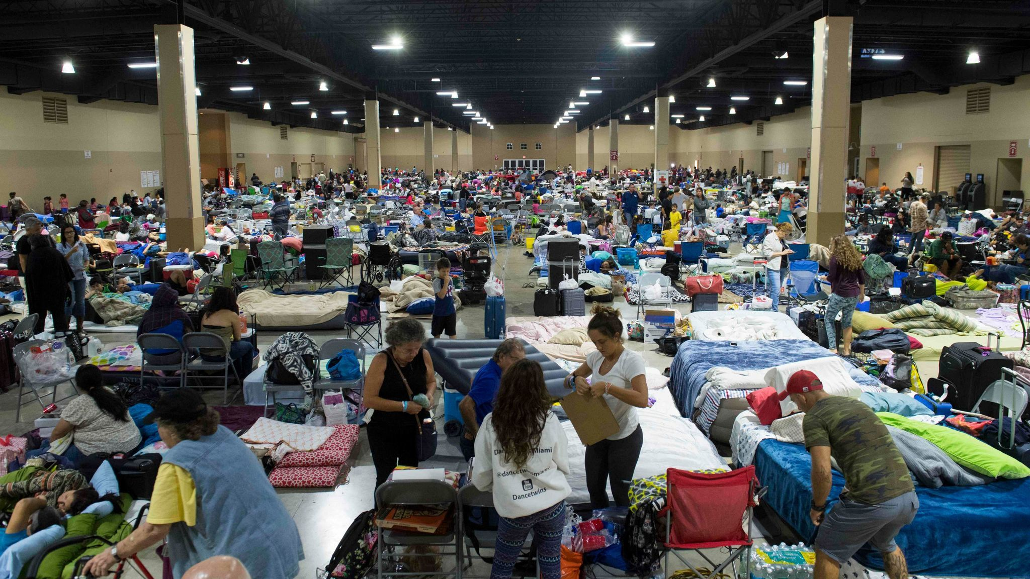 Hundreds of people gather Sept. 8 in an emergency shelter at the Miami-Dade County Fair Expo Center ahead of Hurricane Irma.