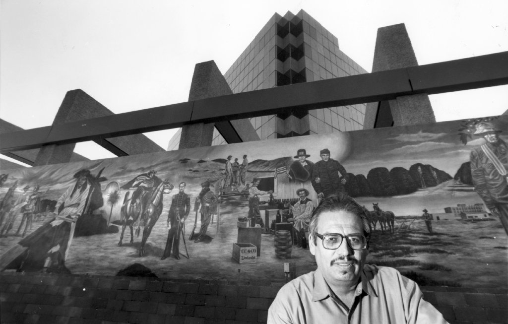 Emigdio Vasuez photographed in 1991 in front of his mural at the Santa Ana Transit Terminal. He originally painted it at the Bowers Museum.
