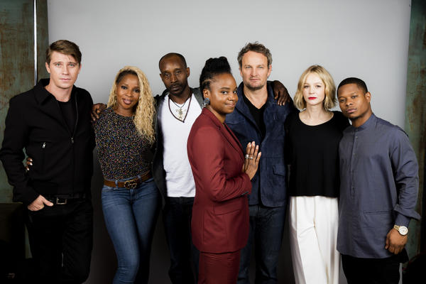 Garrett Hedlund, from left, Mary J. Blige, Rob Morgan, director Dee Rees, actor Jason Clarke, Carey Mulligan and Jason Mitchell from the film
