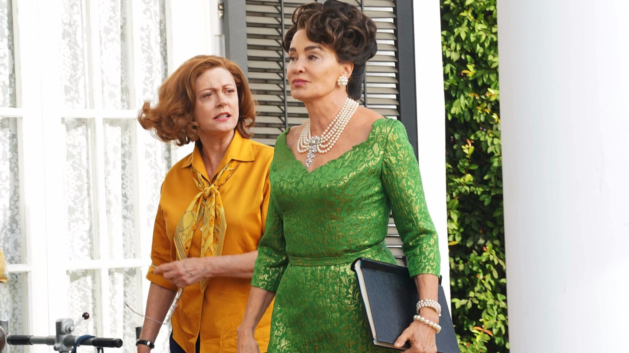 Susan Sarandon as Bette Davis, left, and Jessica Lange as Joan Crawford in a scene from FX's