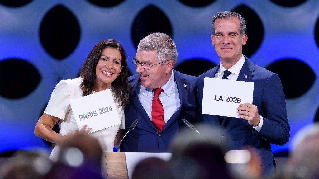 International Olympic Committee President Thomas Bach, center, with Paris Mayor Anne Hidalgo and L.A. Mayor Eric Garcetti after awarding the 2024 and 2028 Olympic Games to their cities in July.