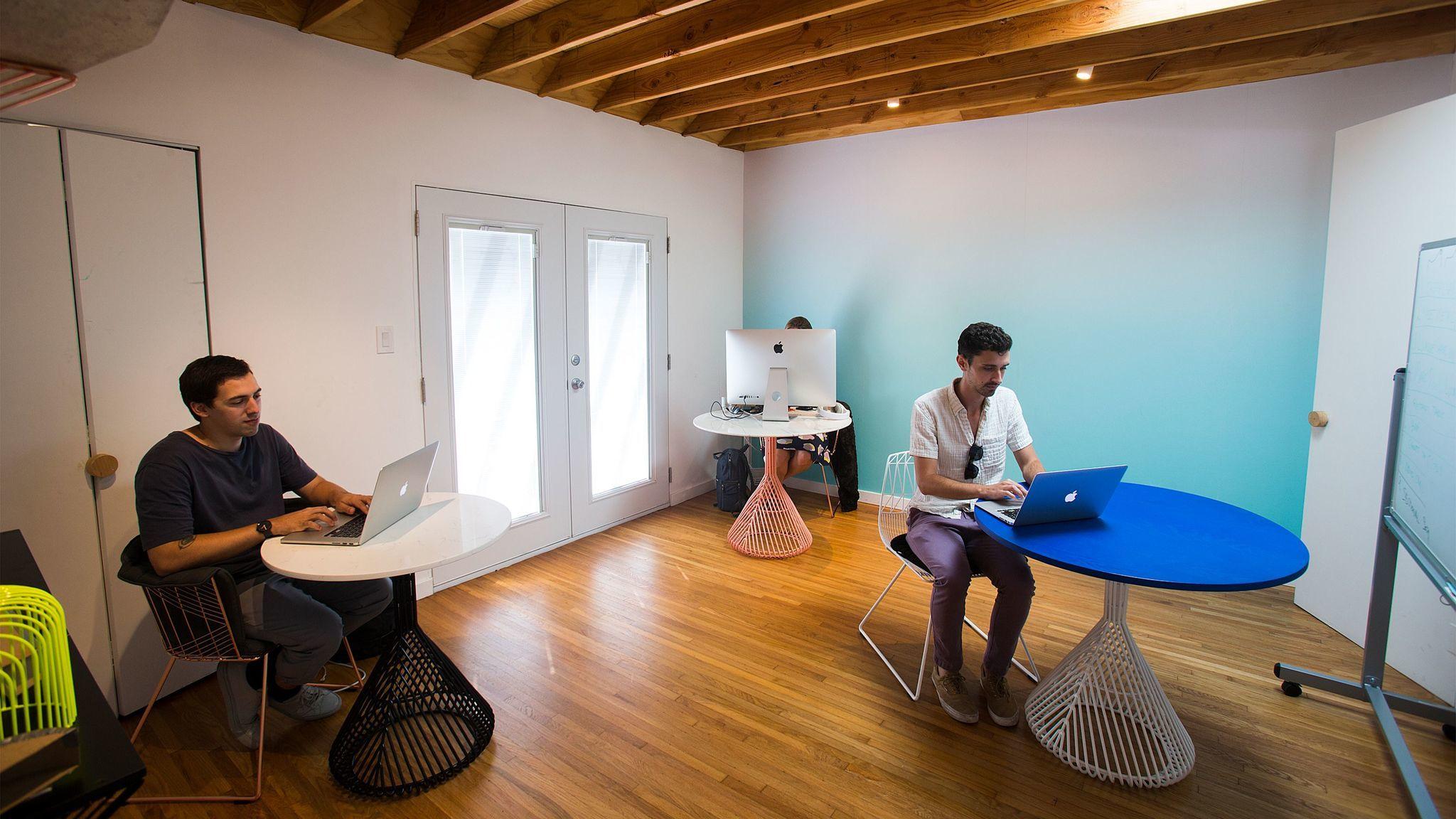 Employees work in an open work space in the home and studio of Bend Goods designer Gaurav Nanda.