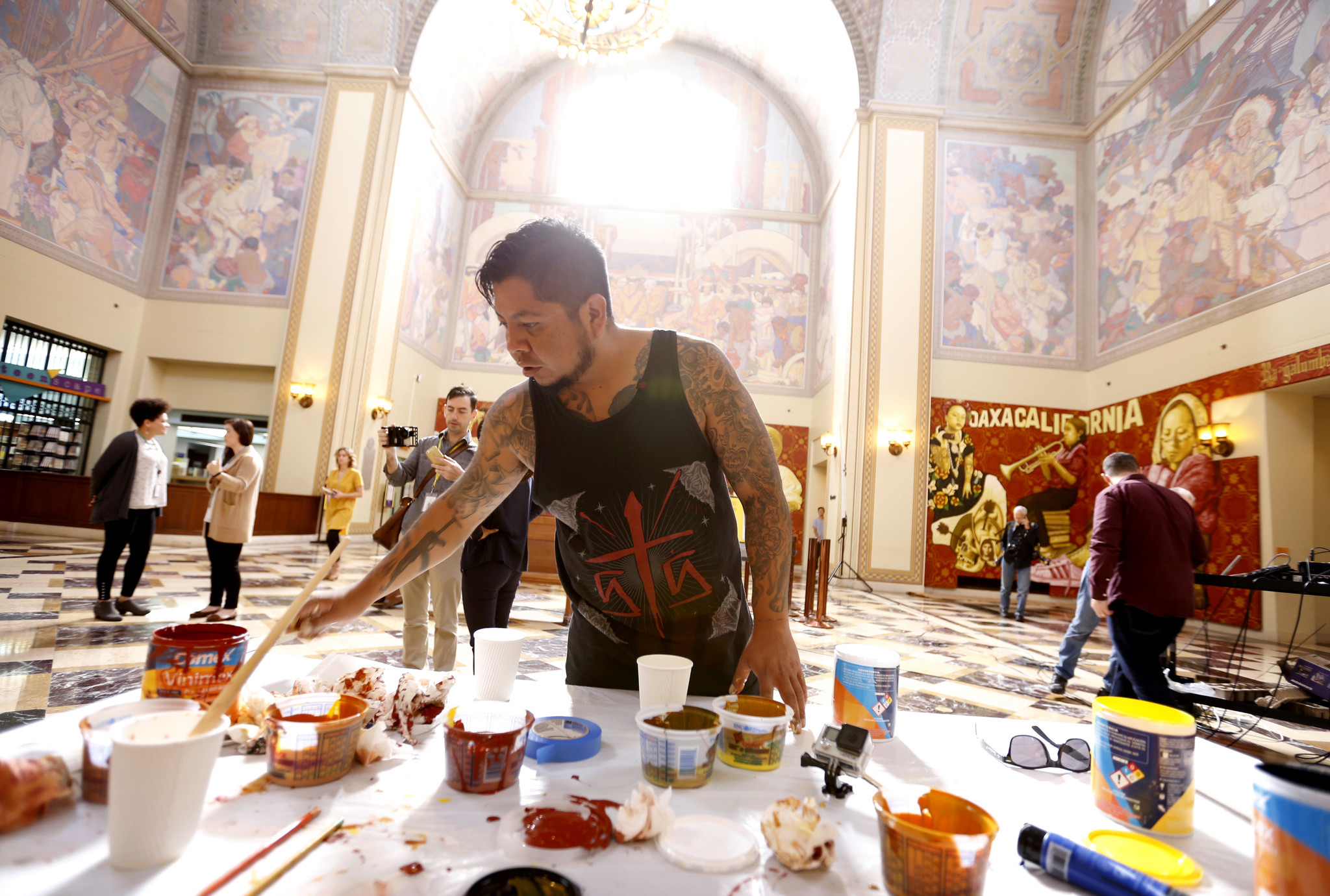 Artist Dario Canul from the Oaxacan collective Tlacolulokos at work in the Central Library.