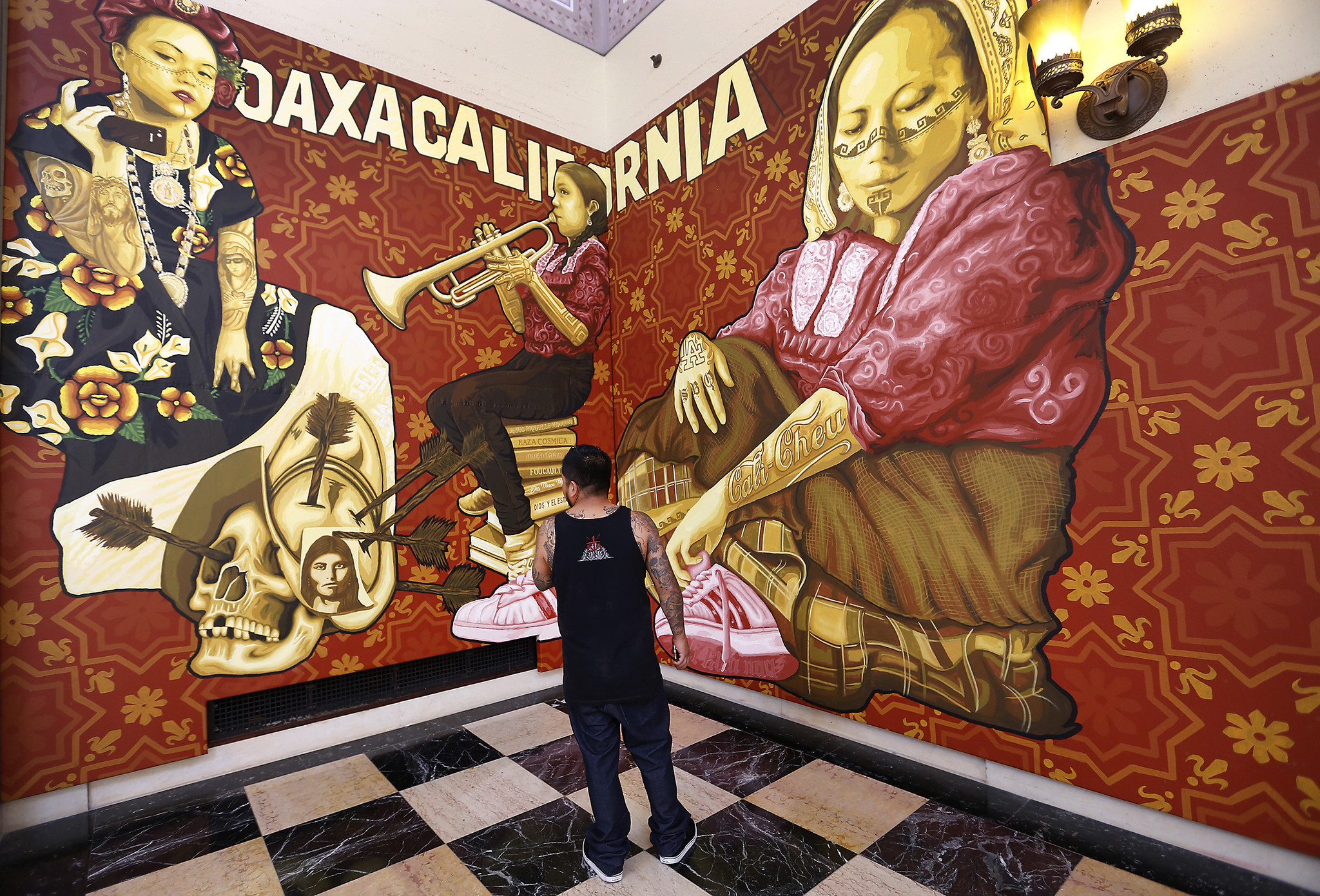 """Canul looks at the """"Oaxacalifornia"""" section of the project."""