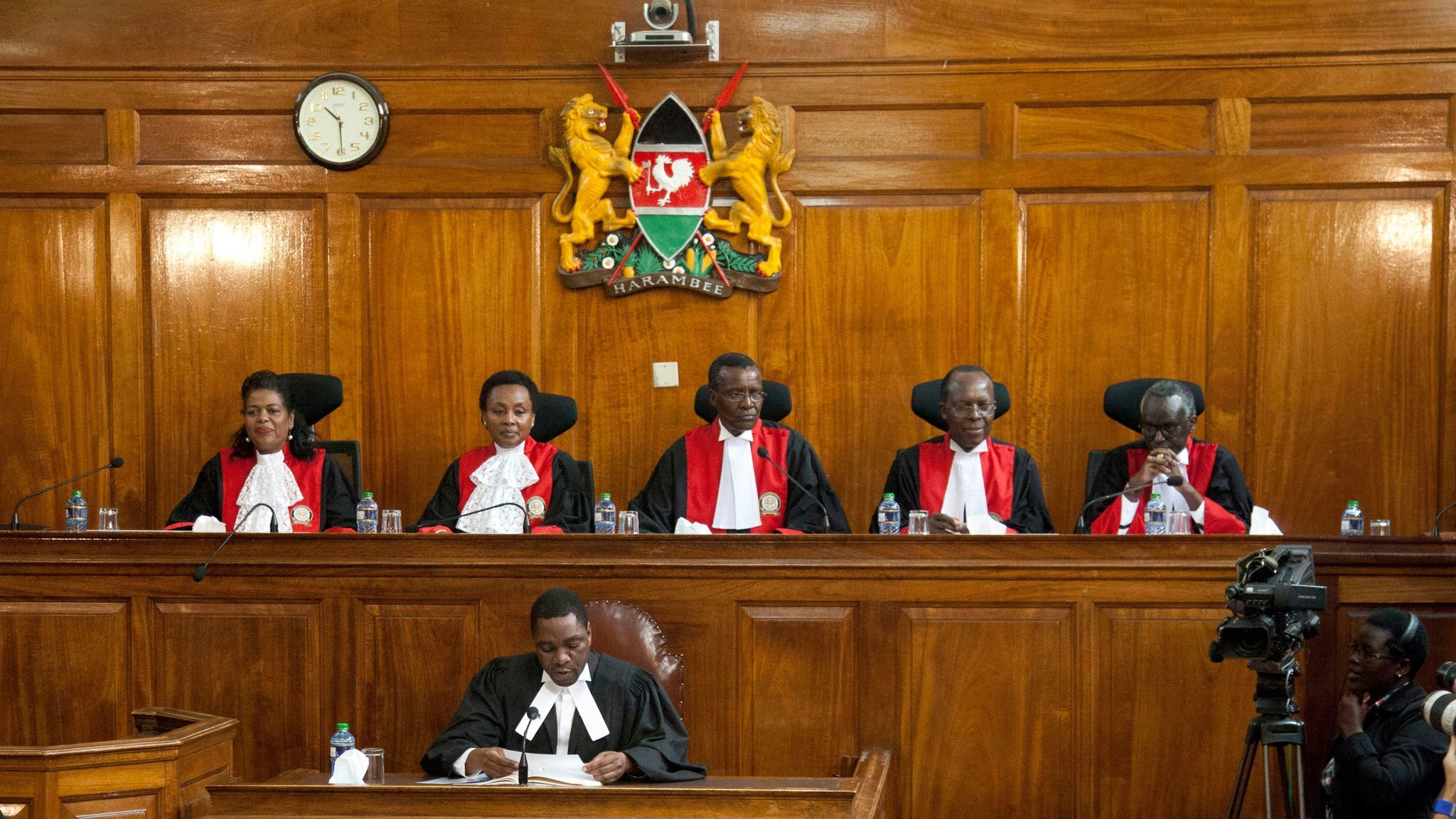 Kenyan Supreme Court judges, from left, Njoki Ndung'u, Deputy Chief Justice Philomela Mwilu, Chief Justice David Maraga, Jackton Ojwang and Isaac Lenaola prepare to deliver their reasons for invalidating the Aug. 8 presidential election.