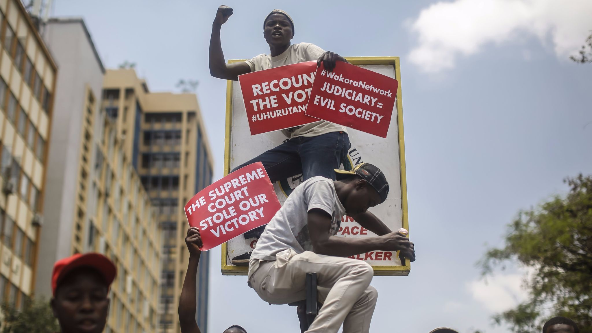 Supporters of Kenyan President Uhuru Kenyatta protest Tuesday against the Supreme Court, which overturned the Aug. 8 presidential election