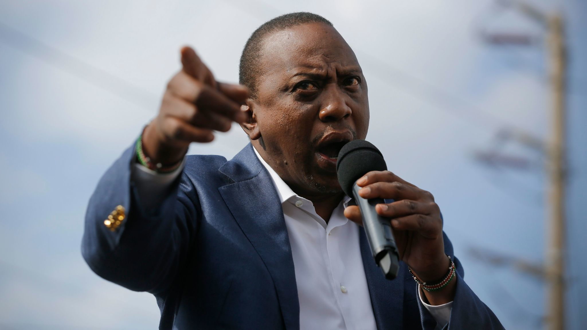 """Kenyan President Uhuru Kenyatta attends a campaign rally outside Nairobi on Sept. 5. Kenyatta threatened to """"fix"""" the judiciary after the Supreme Court invalidated the Aug. 8 presidential election."""