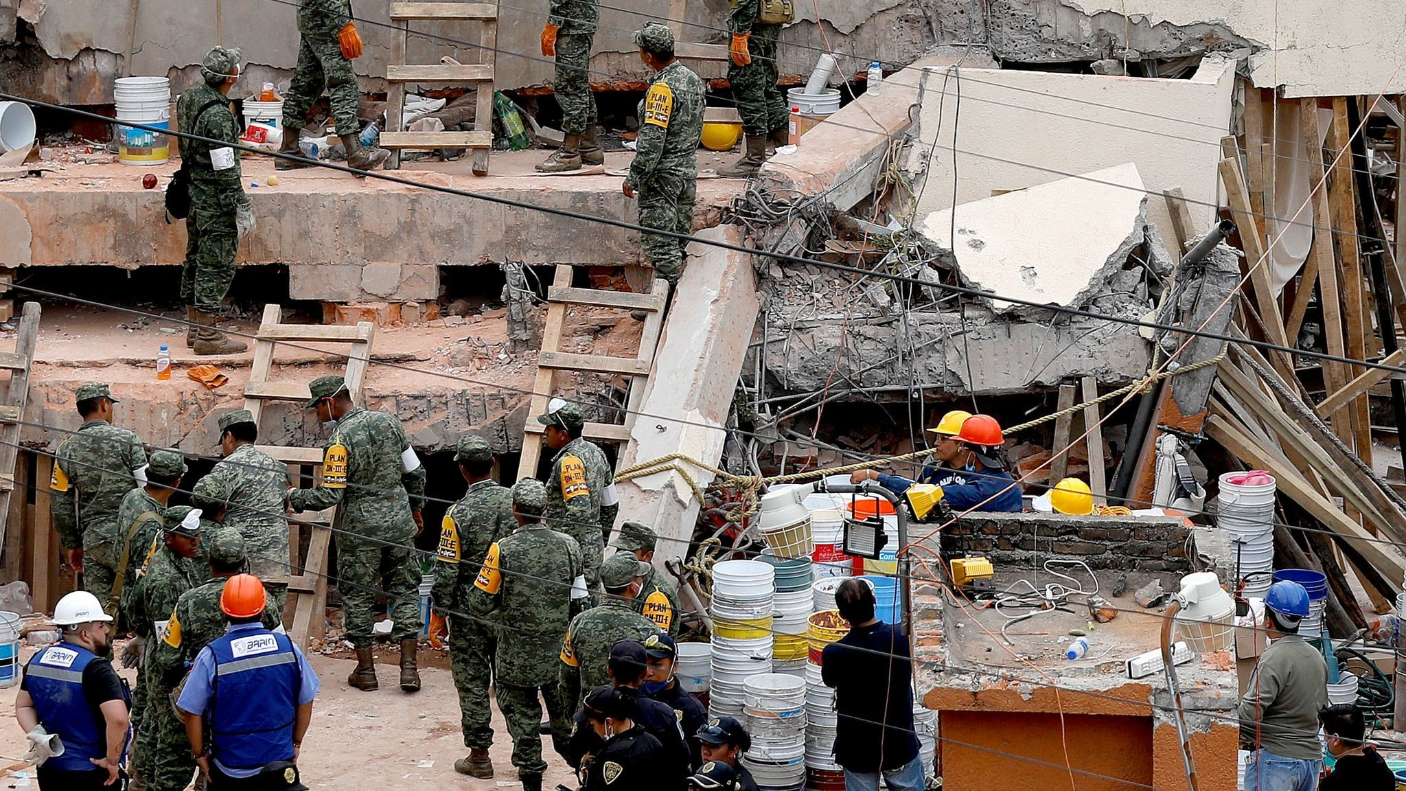 Notice how a concrete column snapped in half at the Enrique Rebsamen school in Mexico City. More reinforcing steel within the column would have prevented the concrete from snapping like a piece of chalk, and enabled it to flex when shaken side to side in an earthquake.