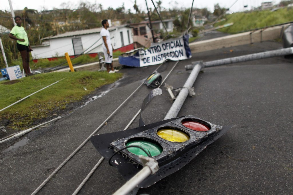 Downed traffic lights and power lines are seen in the aftermath of Hurricane Maria in Luquillo, Puerto Rico, Thursday, September 21, 2017.