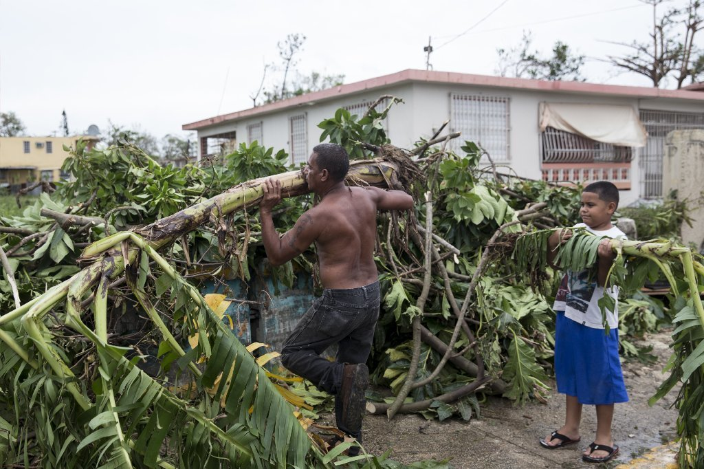 Residents clear the streets after Hurricane Maria made landfall, September 21, 2017 in the Guaynabo suburb of San Juan, Puerto Rico.