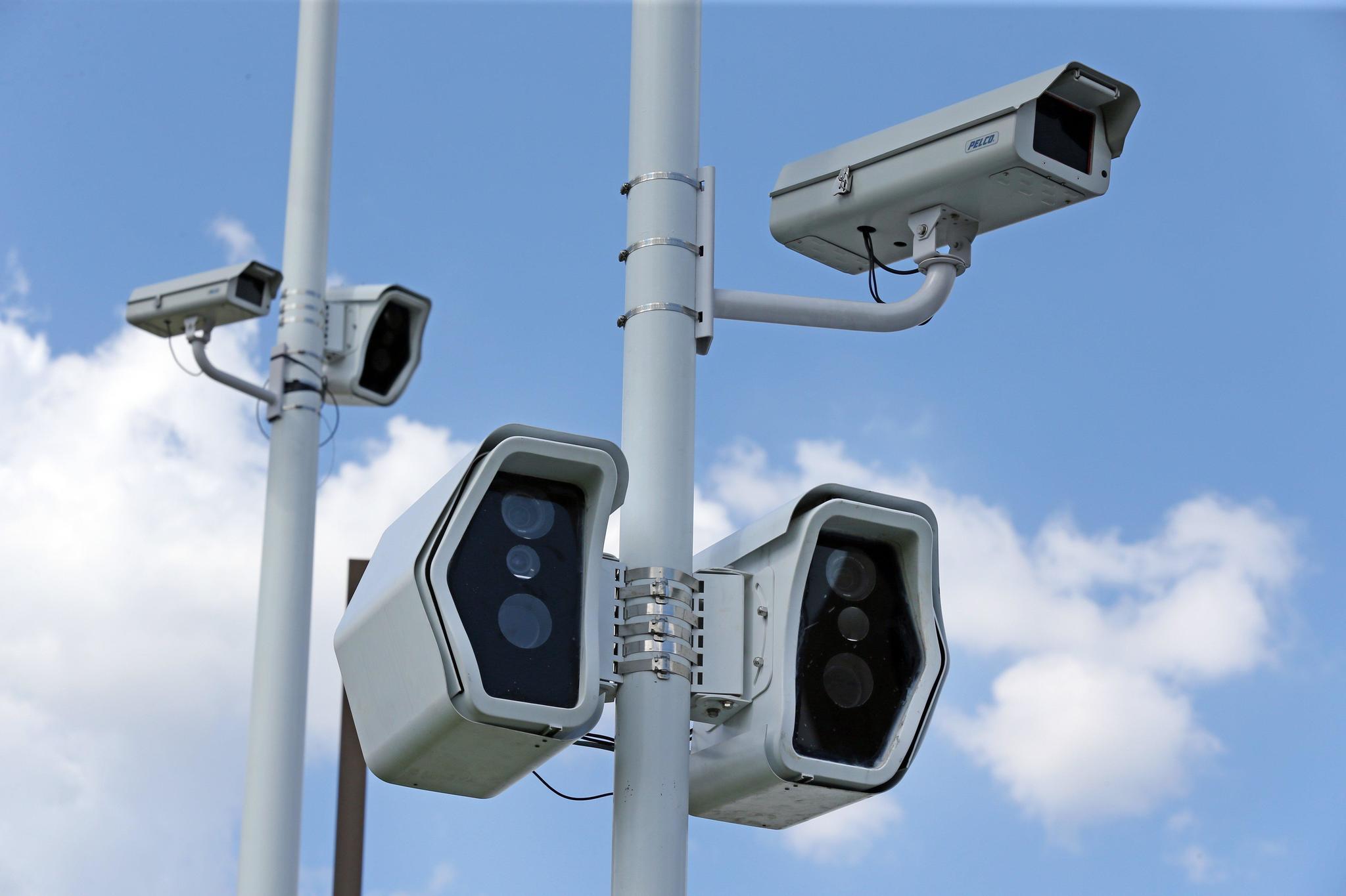 Red-light cameras generate revenue, controversy