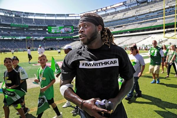 Miami Dolphins running back Jay Ajayi wears a T-shirt in support of Colin Kaepernick before a Sept. 24 game against the New York Jets in East Rutherford, N.J.