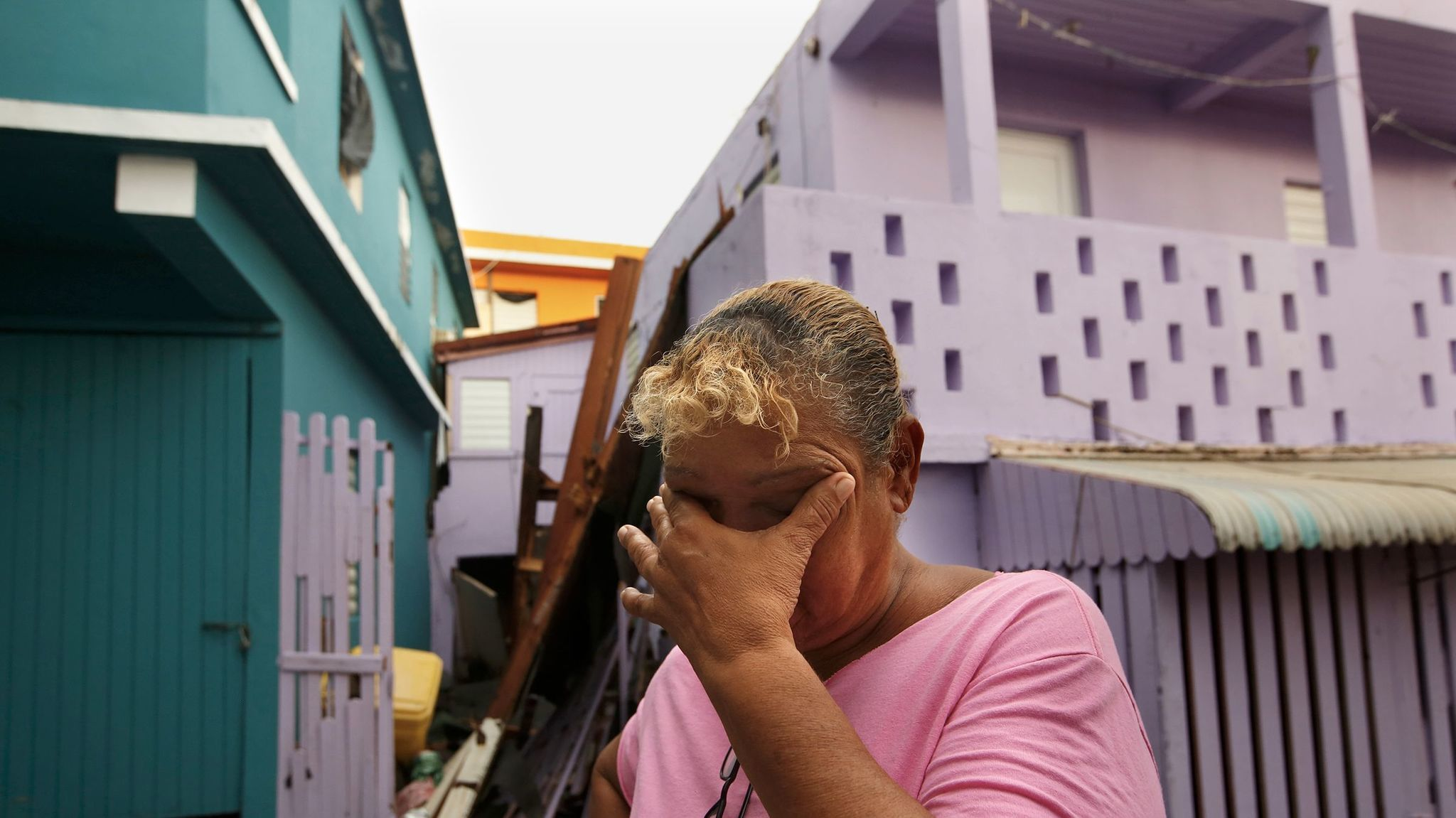 Sonia Viruet, 61, who lives in the La Perla neighborhood, takes stock after Hurricane Maria caused widespread damage across Puerto Rico.