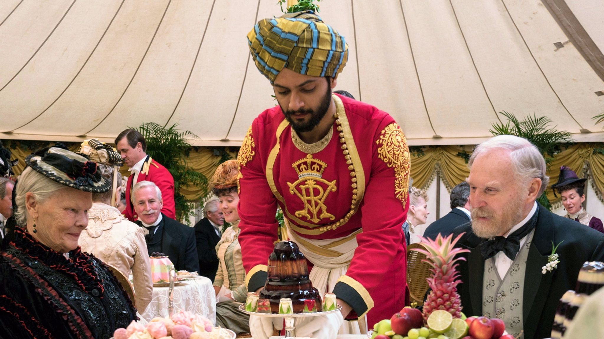 Ali Fazal, center, portrays a servant from India who is befriended by Judi Dench's Queen Victoria. With Tim Pigott-Smith.