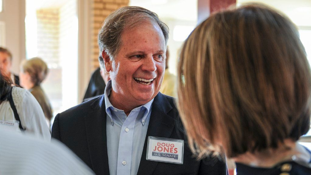 Candidate Doug Jones chats with constituents before a Democratic Senate candidate forum at the Princess Theatre in Decatur, Ala. Thursday, Aug. 3, 2017.