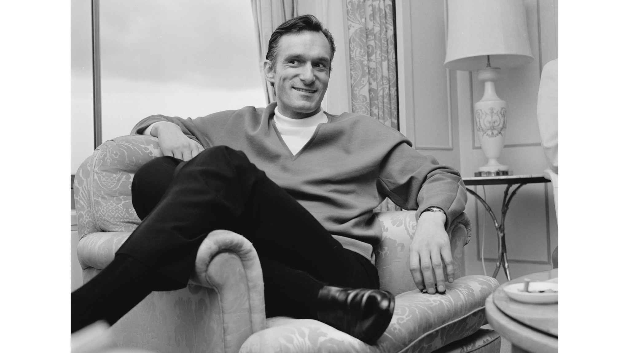 Hugh Hefner, founder of the Playboy empire, relaxes during a visit to England in 1966. (John Downing / Getty Images)