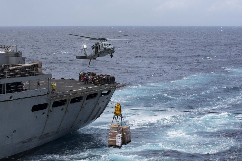 In this U.S. Navy handout, Pallets of supplies are transferred from the fast combat support ship USNS Supply (T-AOE 6) to the amphibious assault ship USS Kearsarge (LHD 3) during a replenishment-at-sea for continuing operations in Puerto Rico on September 28, 2017.