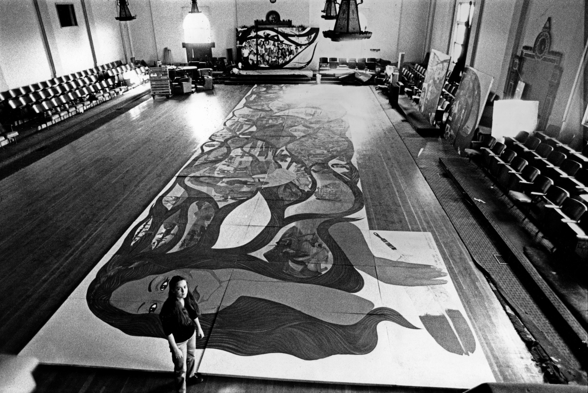Barbara Carrasco is seen with her mural in 1983.