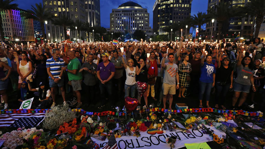 Thousands gather for a memorial at the Plaza at the Dr. Phillips Performing Arts Center in downtown Orlando on June 13, 2016, to honor those killed and wounded in the Pulse nightclub attack.