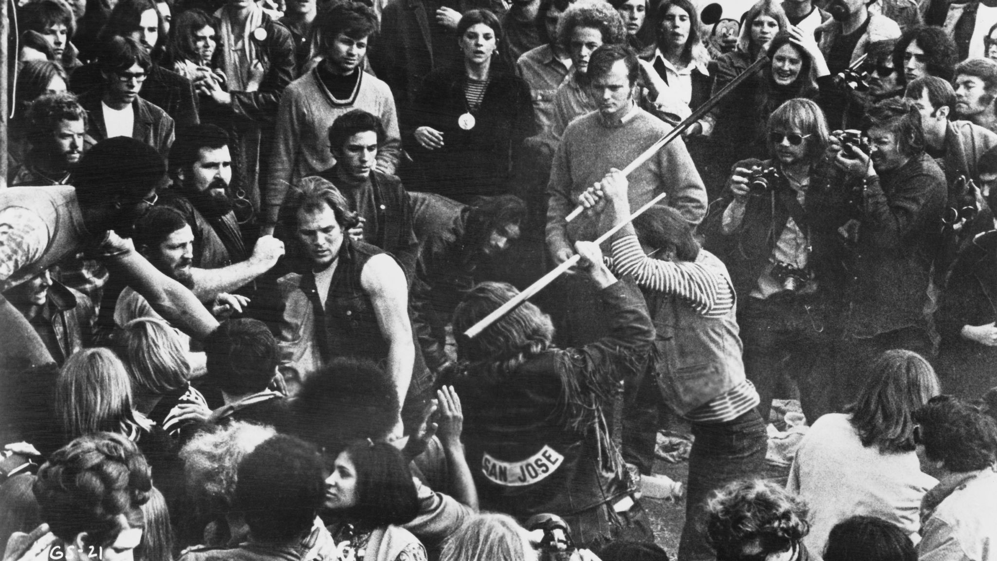 """A still from the documentary """"Gimme Shelter"""" shows the audience looking on as Hells Angels beat a fan with pool cues at the Altamont Free Concert in Northern California on Dec. 6, 1969."""