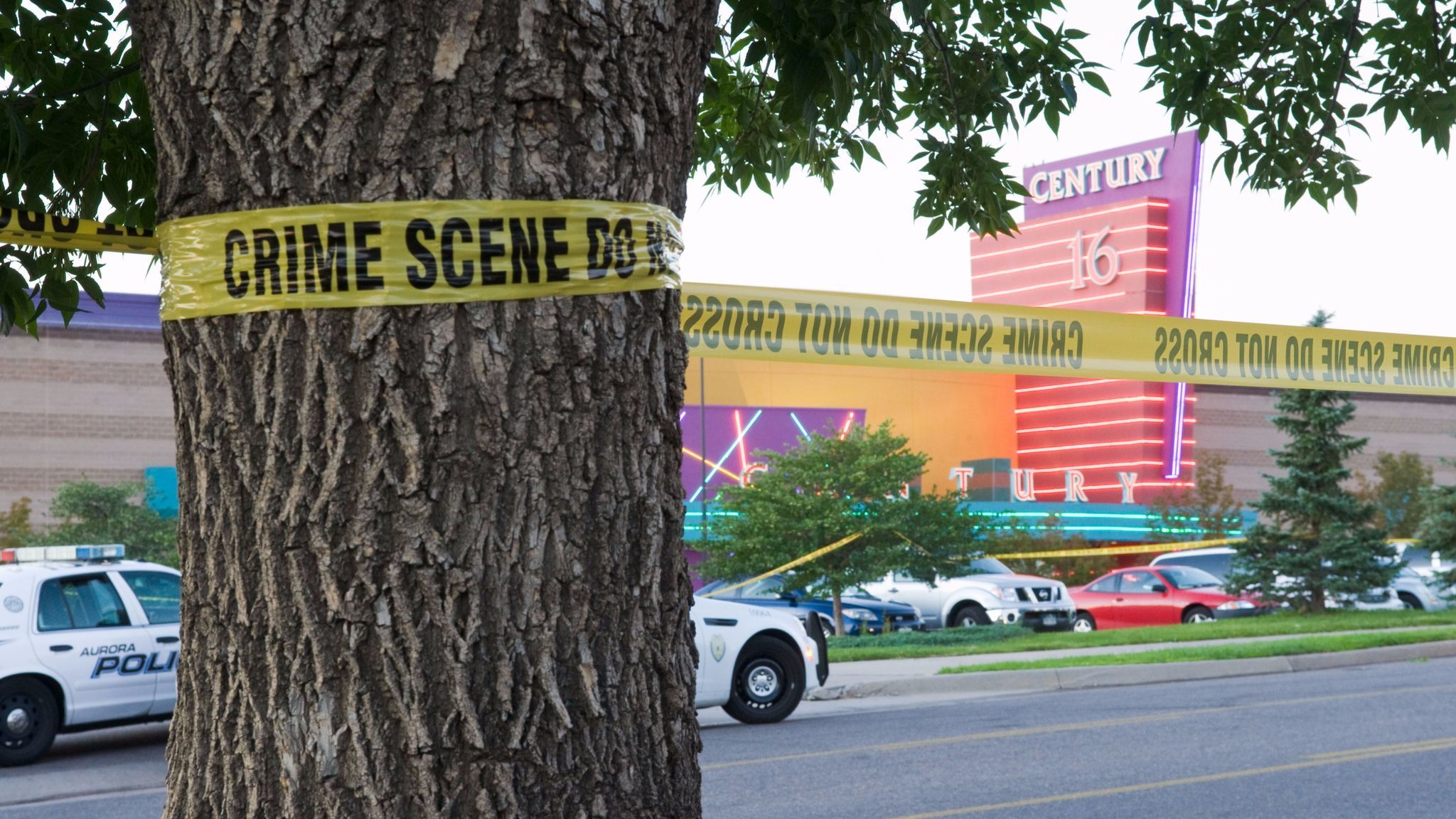 """Police cars in front of the Century 16 theater in Aurora, Colo., where a gunman opened fire during the opening of """"The Dark Knight Rises"""" on July 20, 2012."""