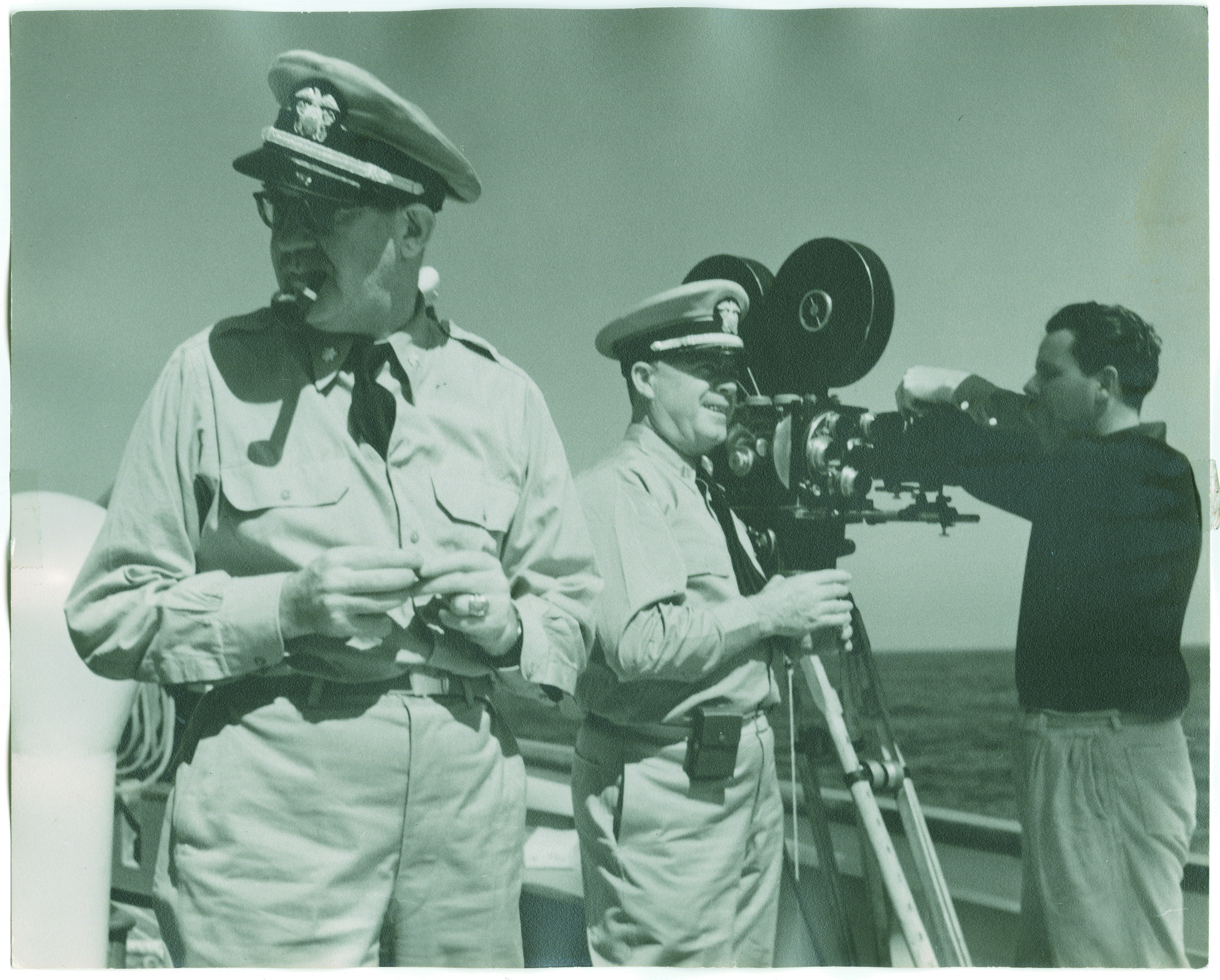 "John Ford, left, next to his cameraman in the Pacific. The image is from ""Filming the Camps: John Ford, Samuel Fuller, George Stevens, From Hollywood to Nuremberg,"" at the Los Angeles Museum of the Holocaust."