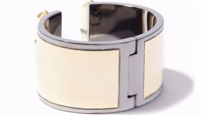 Modern jewelry from local brand Via Saviene will update any wardrobe staple; consider this two-tone cuff made of 14-karat gold and hematite plating with a sprinkling of Swarovski crystals.