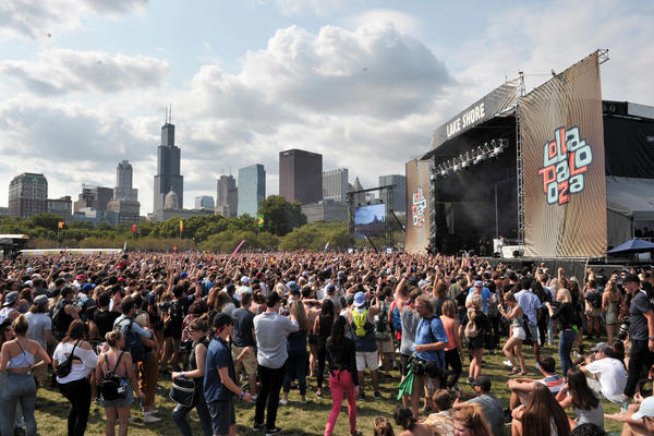 Fans watch as Charli XCX performs at Lollapalooza in Chicago's Grant Park on Aug 6. (Rob Grabowski / Invision/AP)