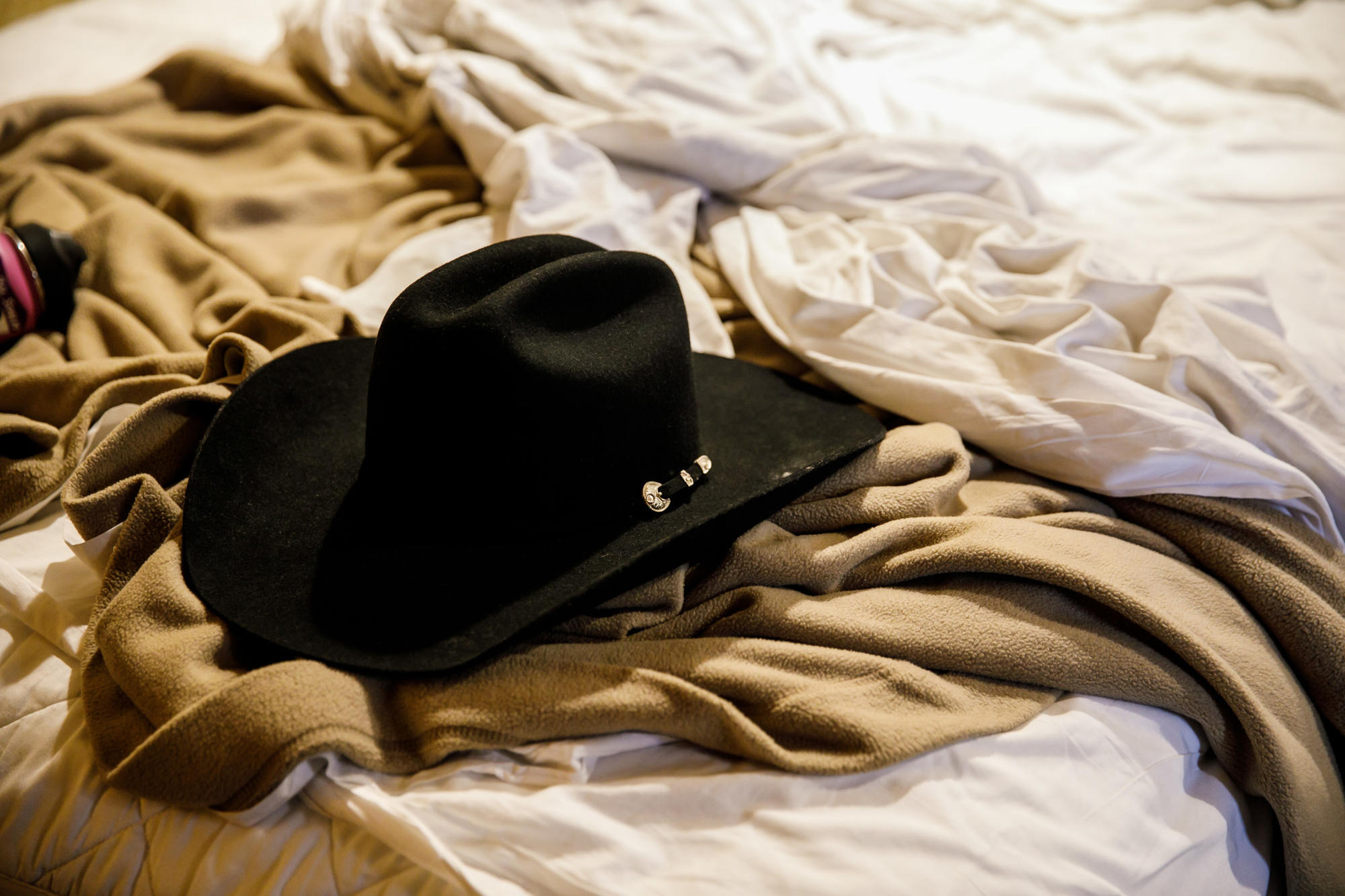 Brian MacKinnon retrieved Adrian Murfitt's new cowboy hat and took it back to their hotel room.
