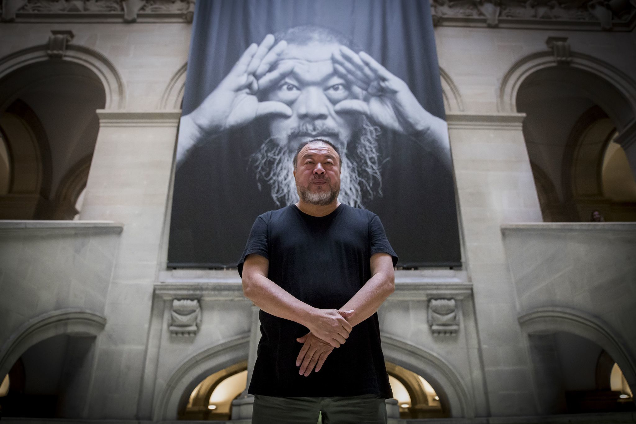 Ai Weiwei at the entrance to his exhibition