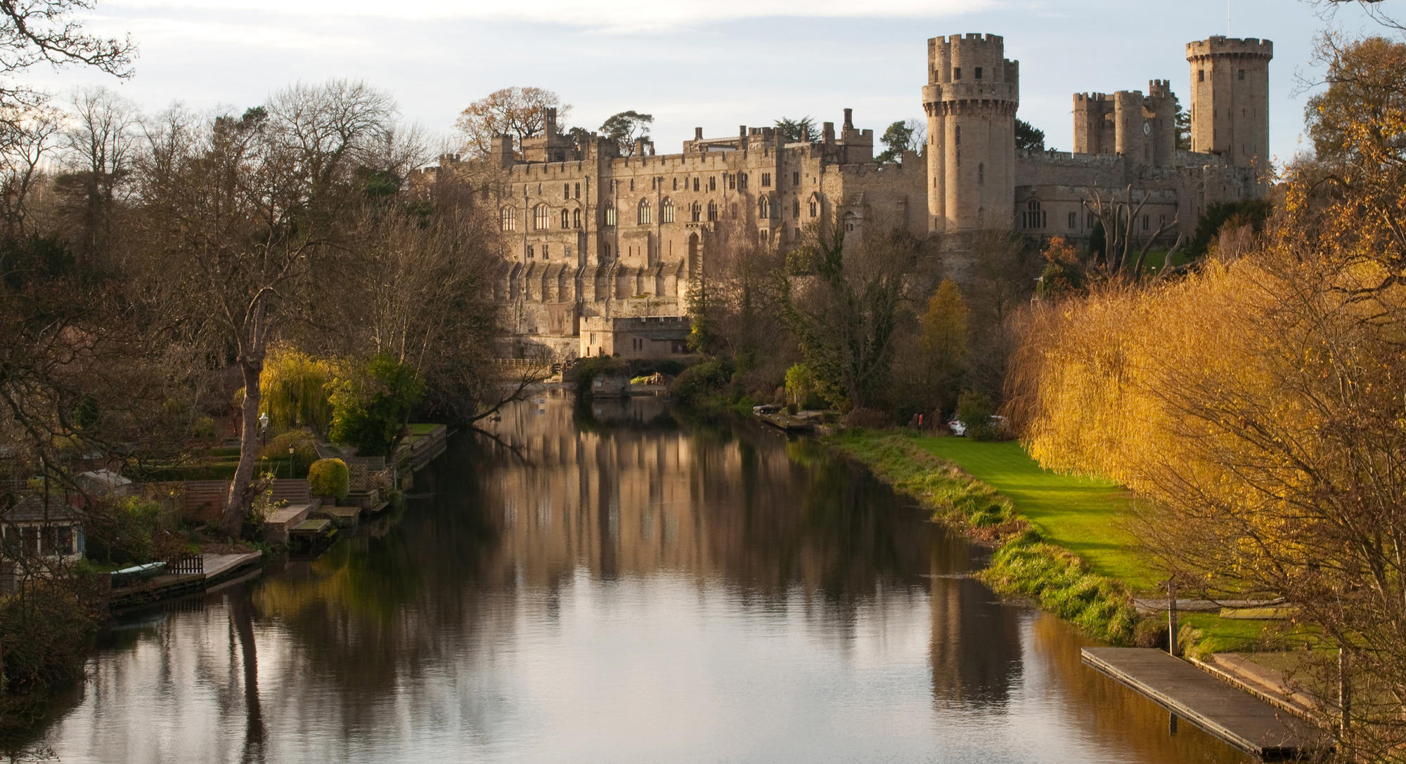 Autumn colours at Warwick castle on the river Avon, England.