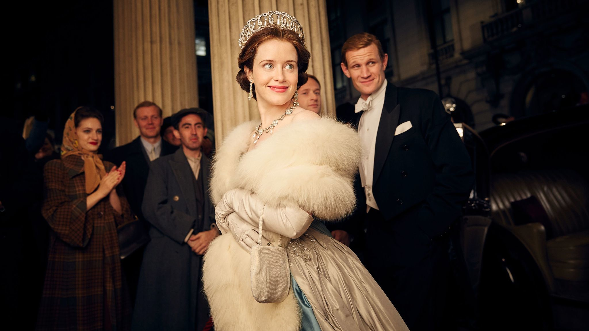 "Claire Foy, center, and Matt Smith, right, in ""The Crown."""