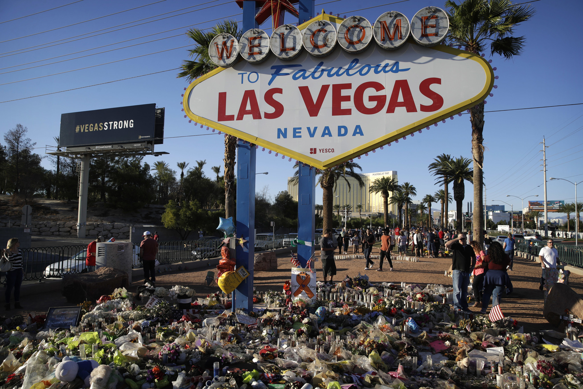 Flowers, candles and other items surround the famous Las Vegas sign at a makeshift memorial for victims of the Oct. 1 mass shooting.