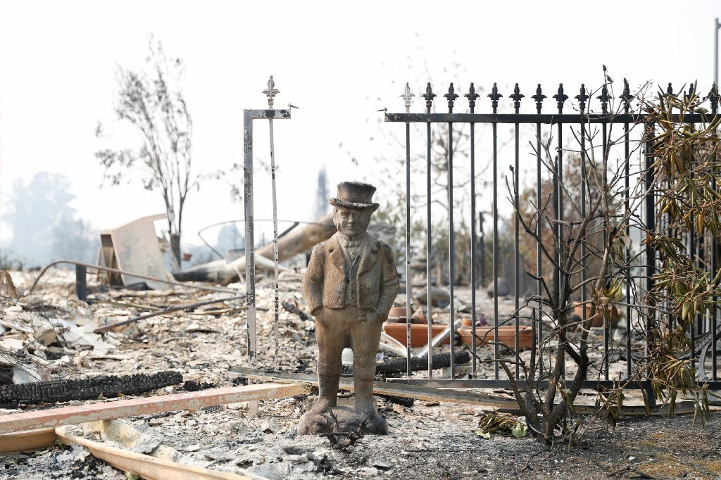 A statue stands amongst a home destroyed by the Tubbs Fire in Santa Rosa, California, U.S., Oct. 10, 2017.