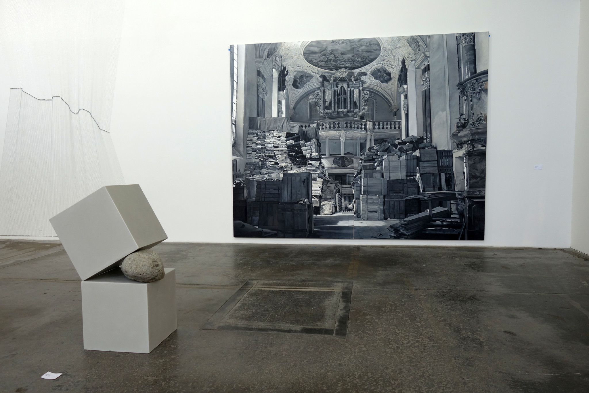 A 2017 sculpture by Mexican artist José Davila sits before a 2015 canvas by Chilean artist Josefina Guilisasti.