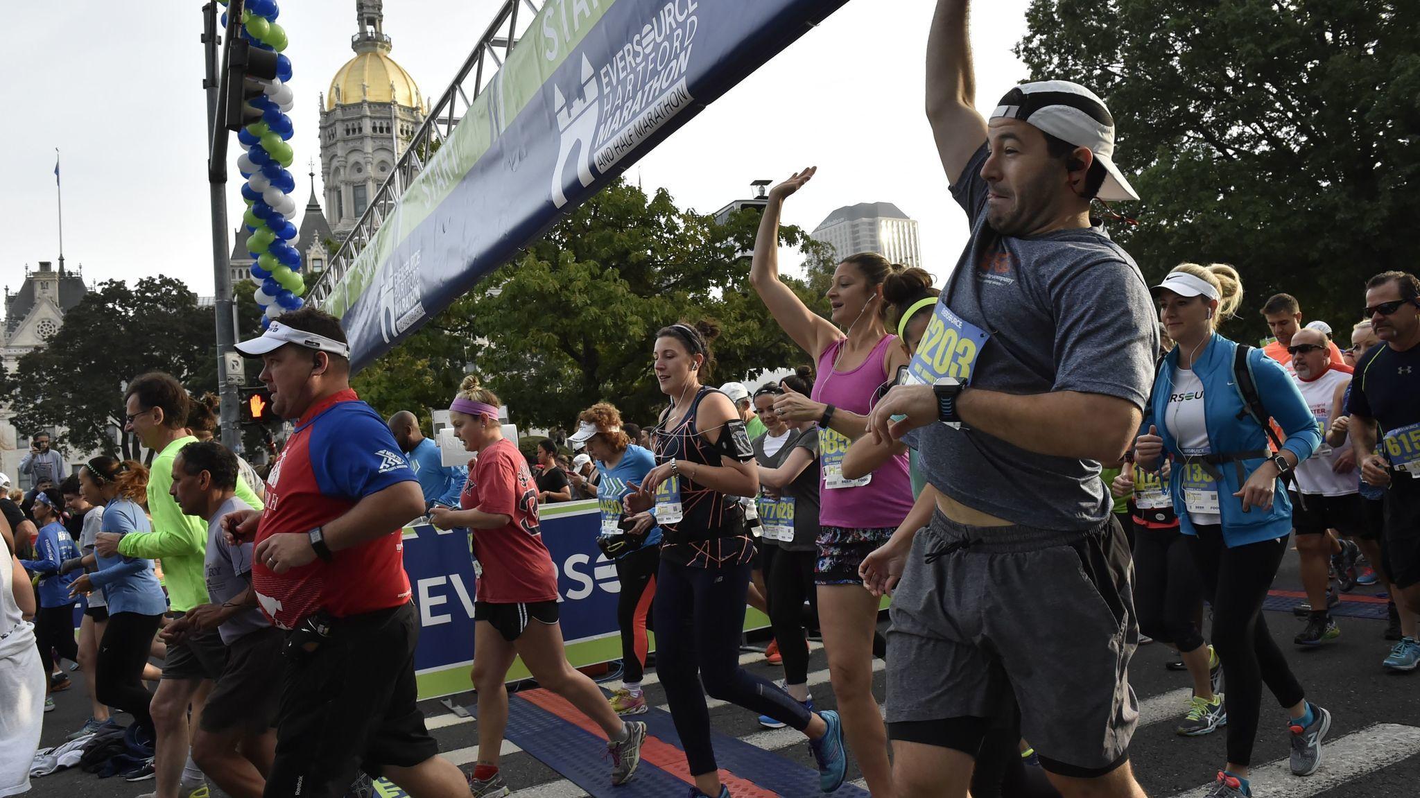Runners cross the starting line at the Hartford Marathon.