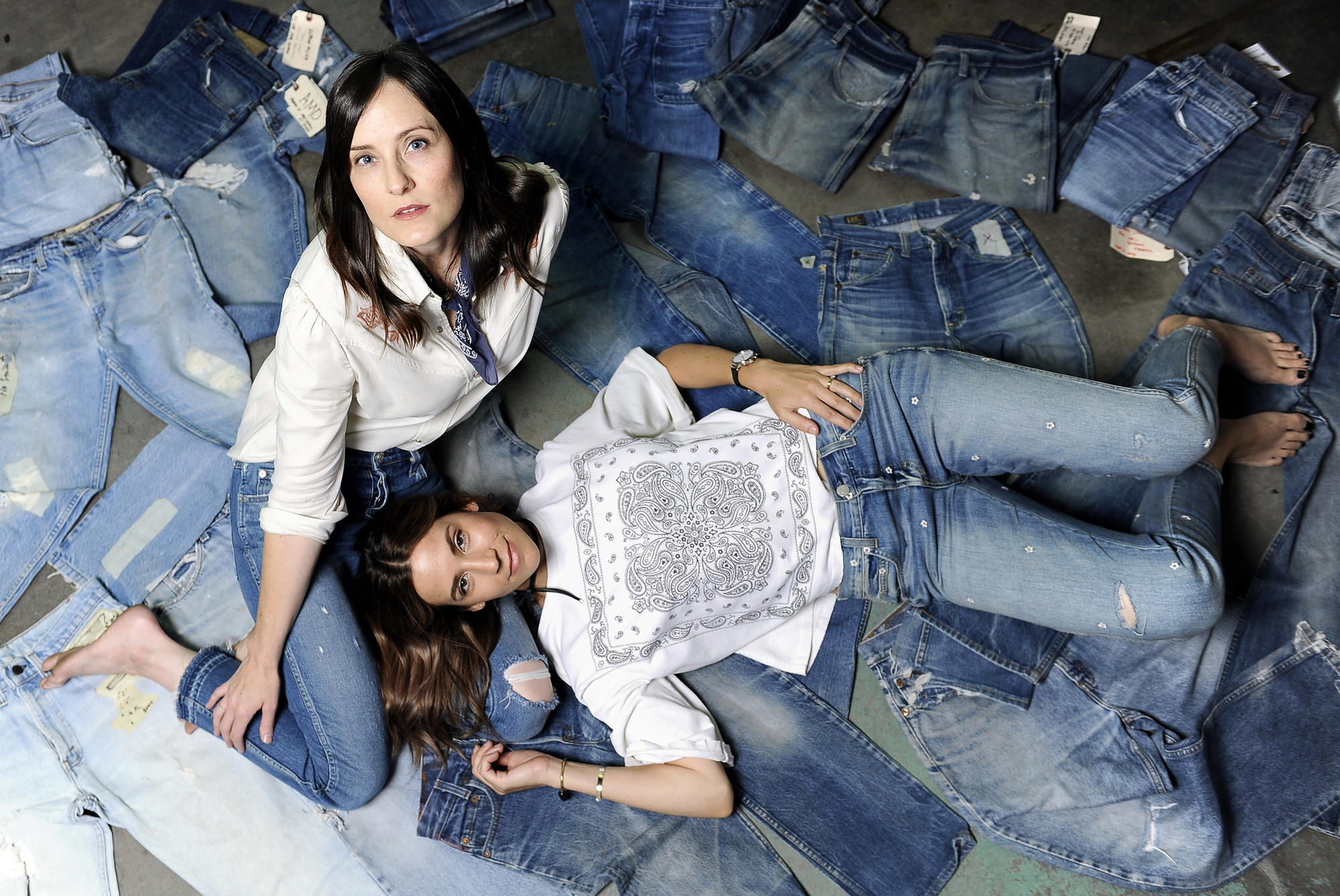 Misty Zollars, left, and Kelly Urban, friends and co-founders of L.A.-based denim label Amo.