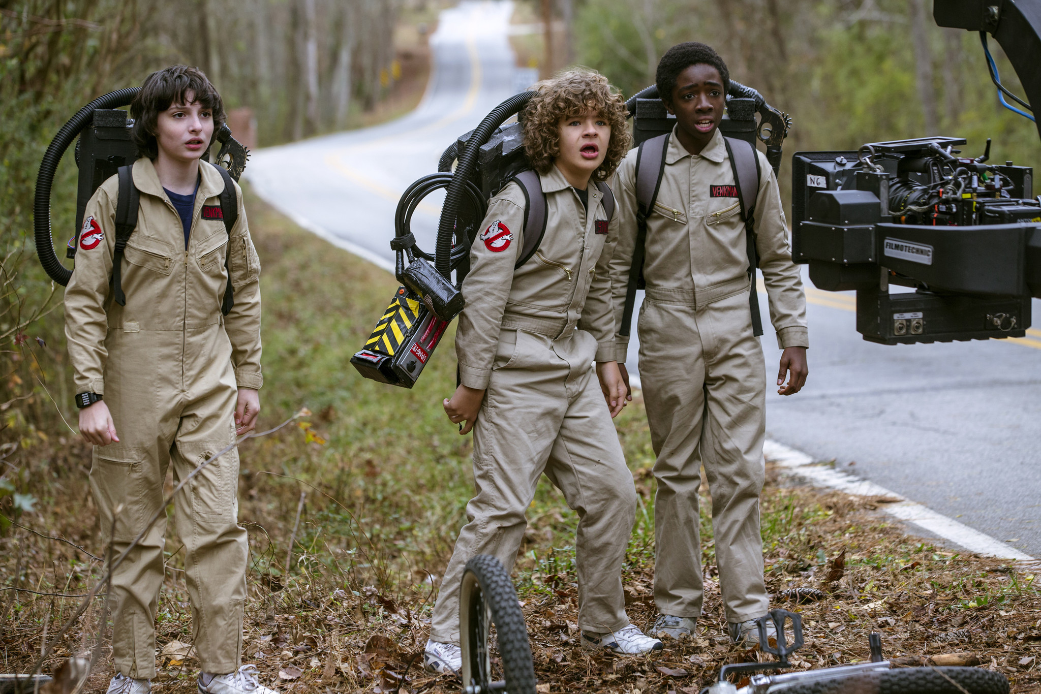 "Finn Wolfhard, left, Gaten Matarazzo and Caleb McLaughlin on the set of ""Stranger Things."""