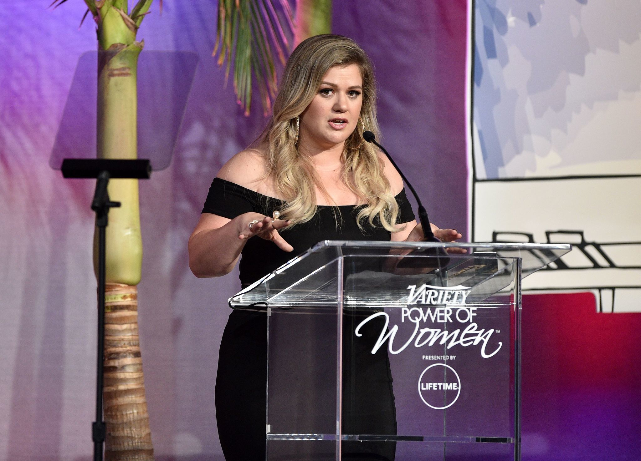 "Honoree Kelly Clarkson tells a story about the power of ""Wonder Woman"" during Variety's Power of Women luncheon in Beverly Hills."