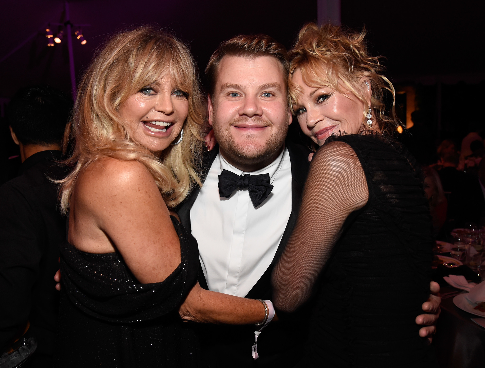 Goldie Hawn, from left, event host James Corden and Melanie Griffith attend the amfAR Gala Los Angeles at Ron Burkle's Greenacres estate in Beverly Hills.
