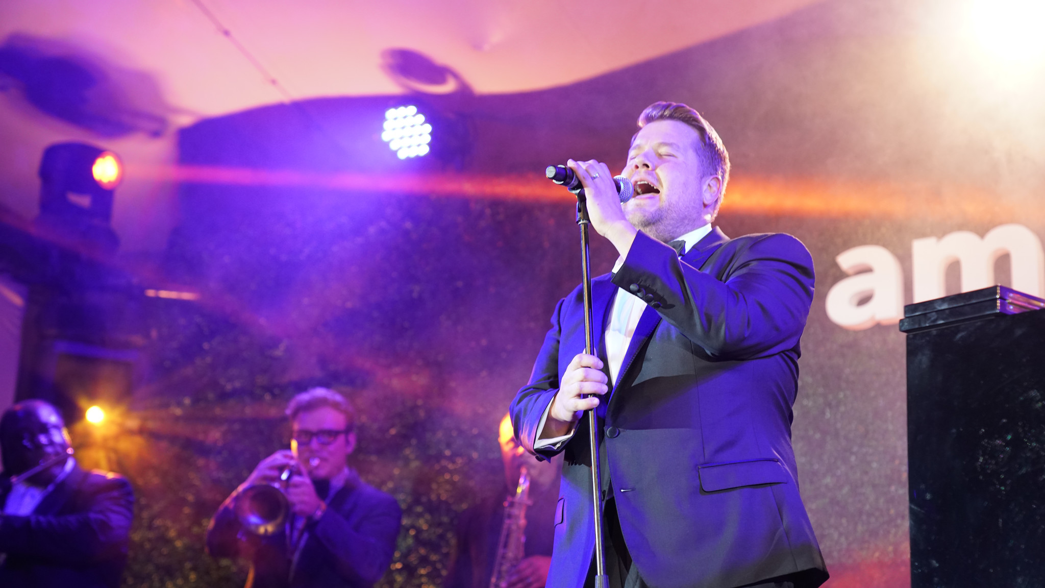 Host James Corden performs during the amfAR Gala Los Angeles in Beverly Hills.