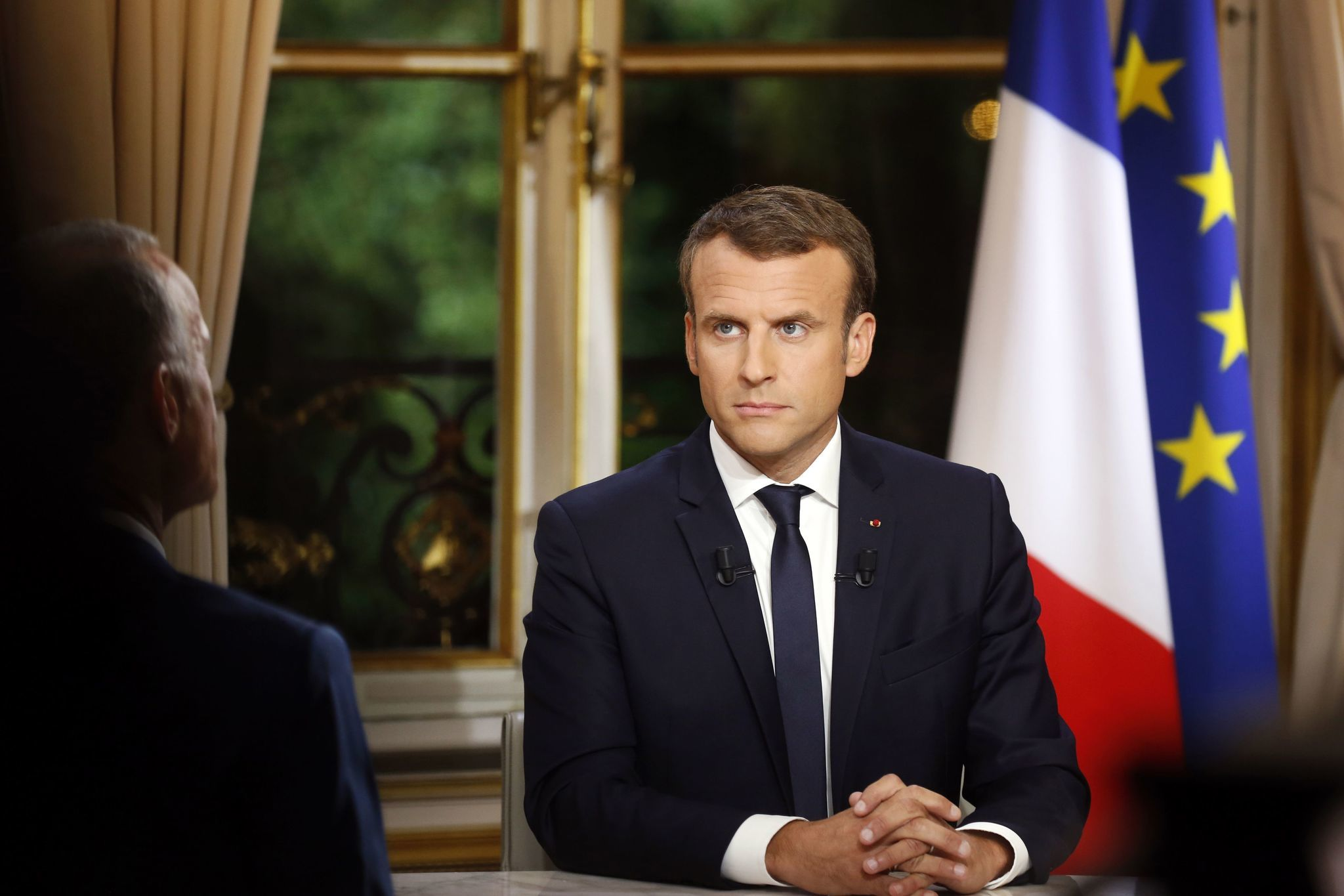 French President Emmanuel Macron is interviewed at the Elysee Palace in Paris on Sunday. (Philippe Wojazer / Pool)