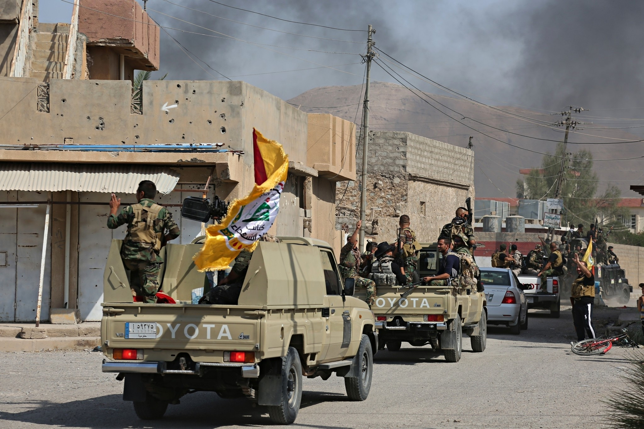 After Kirkuk, Kurdish forces pull out of more areas in ...