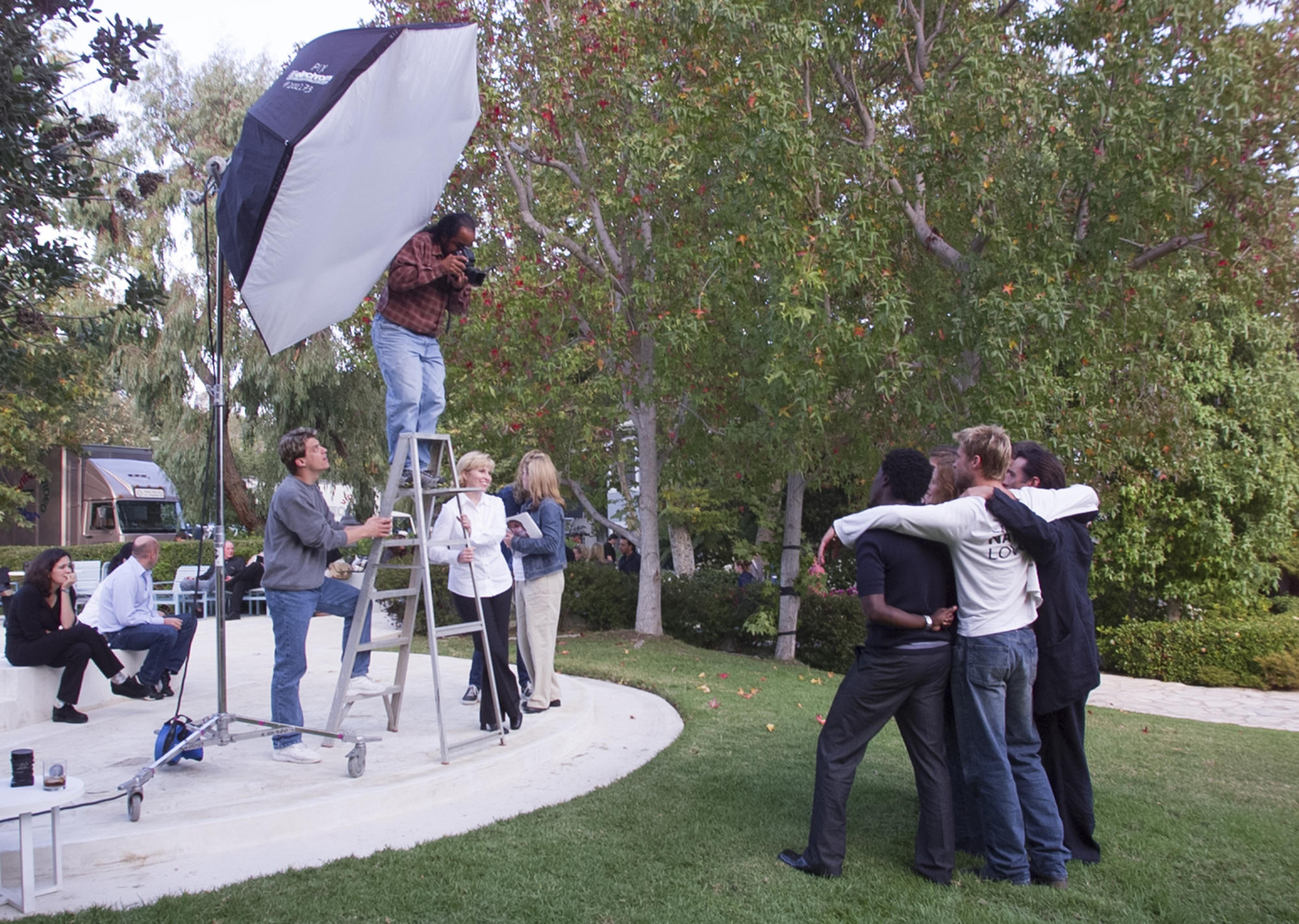 Anacleto Rapping stands atop a ladder during a portrait shoot for