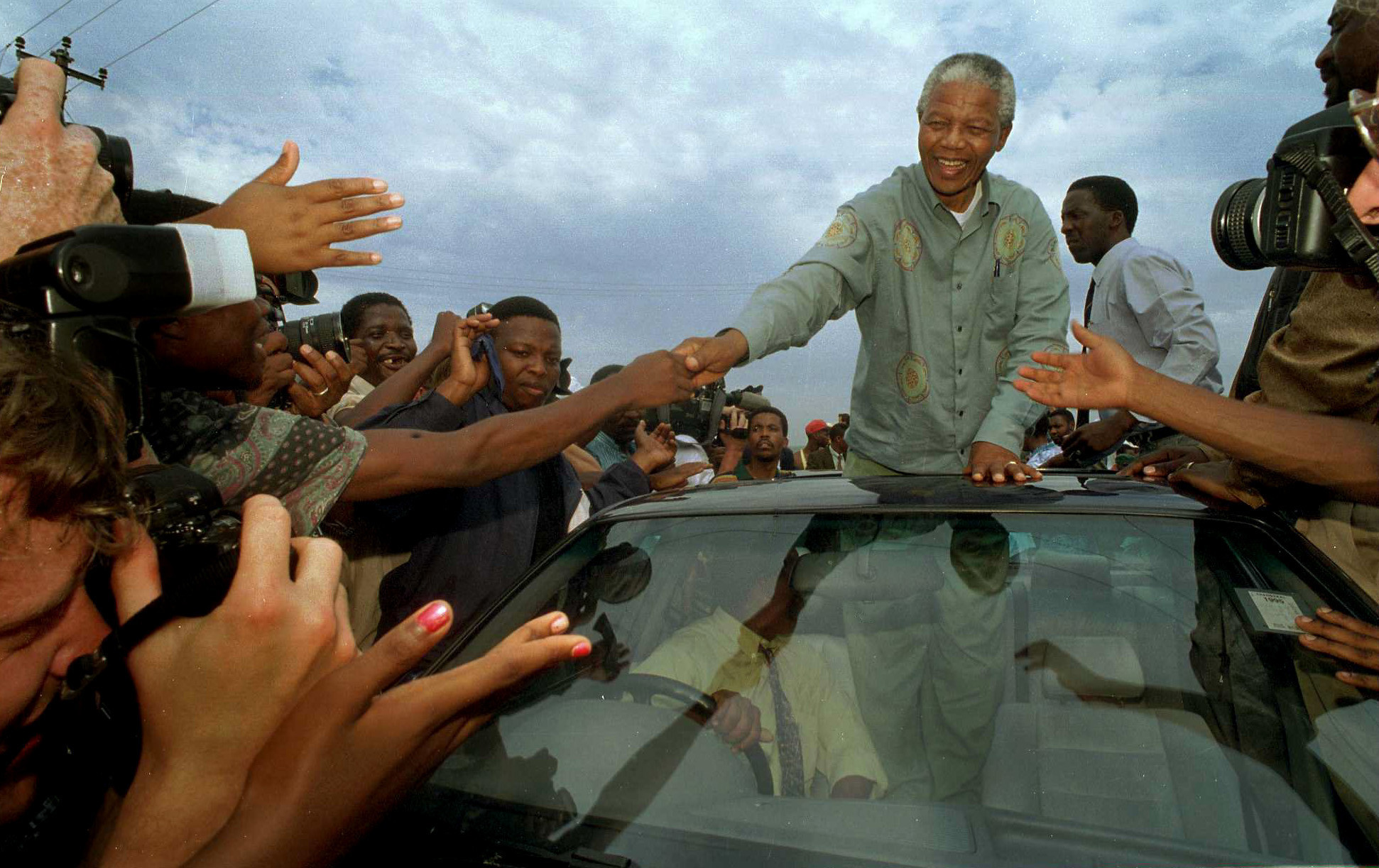 Nelson Mandela is swarmed in Lamontville township during his presidential bid in 1994, when South Africa held its first multiracial democratic elections and the ANC swept to power.
