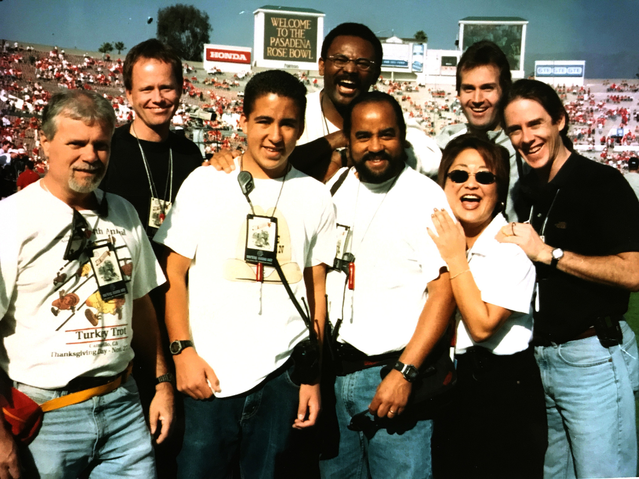 Anacleto Rapping, center, with his son Mathew, at the Rose Bowl.