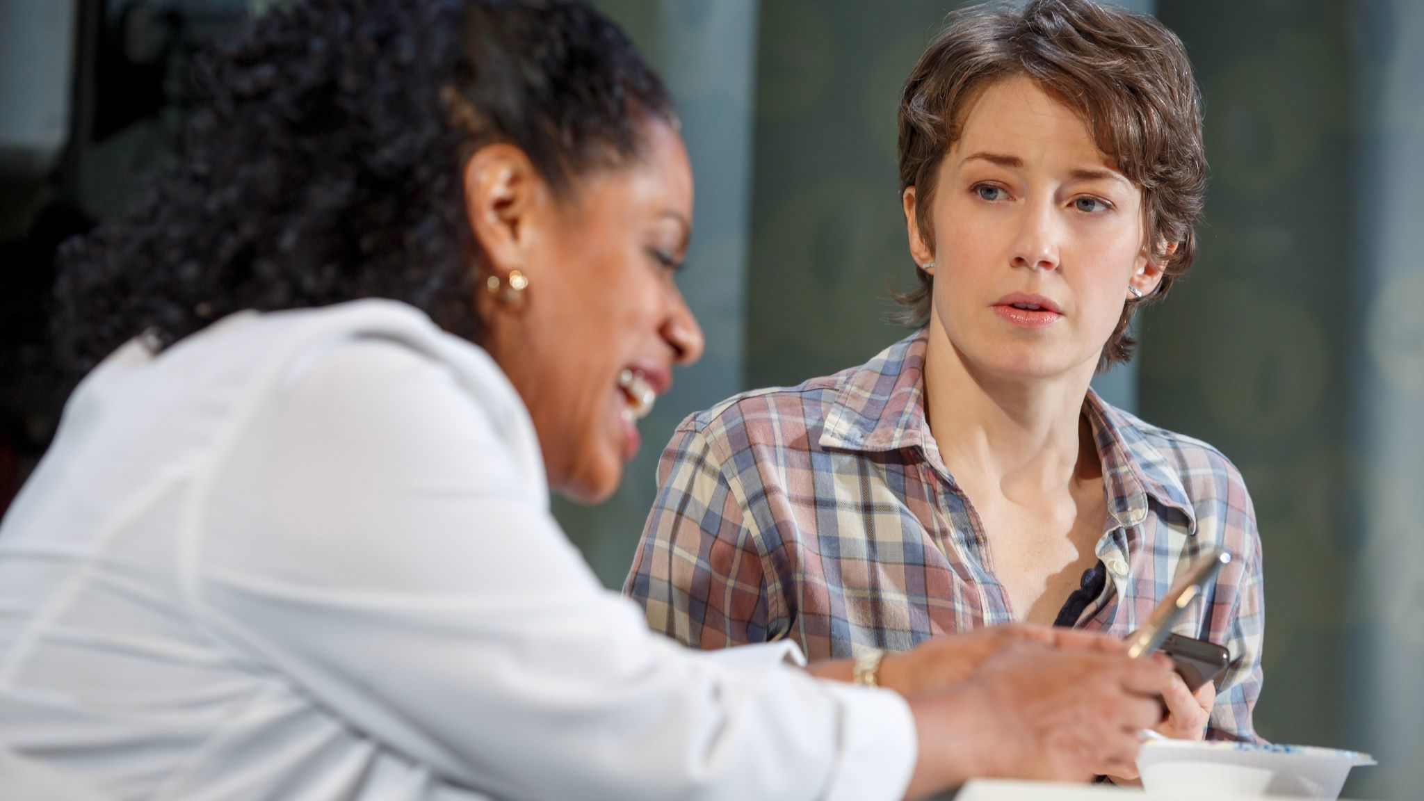 """Carrie Coon listening to Liza Colón-Zayas in """"Mary Jane"""" at the New York Theatre Workshop."""